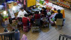Tamale cook in market area, wrapping rice and beef into banana leaf Stock Footage