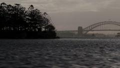 Sydney Harbor panorama - bridge, opera house from behind island - stock footage