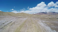 Car driving on road of pastoral areas,Qinghai,China - stock footage