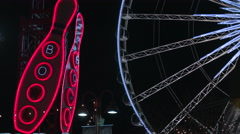 Neon Bowling Sign with Ferris Wheel. - stock footage