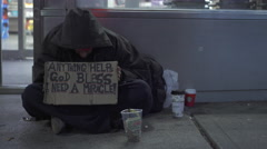 Man on sidewalk with anything helps sign in New York City 4k Stock Footage