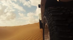 camera  mounted near a tire of a off-road car - stock footage