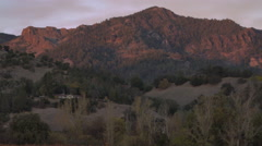 Sunset on vineyards and mountains zooming in to out Stock Footage
