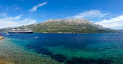 Big cruiser anchored in bay next to Korcula island, Croatia. Stock Photos