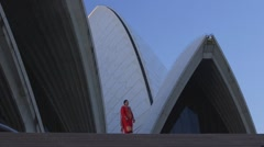 Sydney Opera House - Indian woman in beautiful red salwar kameez on stairs Stock Footage