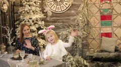 Mother and daughter in white costume of rabbit are waving hands goodbye. - stock footage
