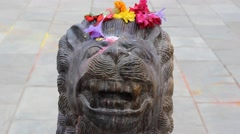 Statue of a tiger with flowers Stock Footage