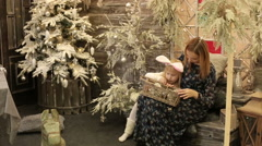 Mother and daughter choosing Christmas toys for the New year tree. Stock Footage