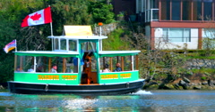 4K Tiny Harbor Ferry, Canadian Flag, Vancouver Victoria British Columbia - stock footage