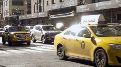 Busy traffic on sunny day with cabs on 8th Ave sun reflecting off cars driving Stock Footage
