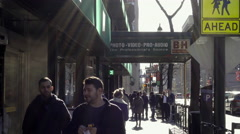 People walking outside BH Photo Superstore, exterior shot on 9th Ave in 4K NYC - stock footage