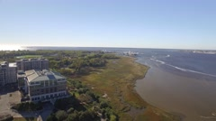 Aerial Shot of Naval Ship and Office Park Across from Downtown Charleston, SC Stock Footage