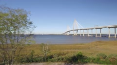 Aerial Shot Zooming out over Cooper RIver to Ravenel Bridge in Charleston, SC Stock Footage