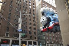 Thomas the train between buildings at 2015 Thanksgiving Parade Stock Photos