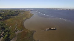 Aerial Shot Zooming Back from the Cooper River to a Naval Ship and Office Park Stock Footage