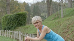 Portrait of athletic senior woman leaning on fence Stock Footage