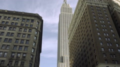 Tilting down from Empire State Building busy Herald Square street crowded NYC 4K Stock Footage