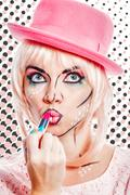 Girl with makeup in style pop art lipstick paint. - stock photo