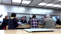 Stock Video Footage of People listening the Apple worker introducing new app inside Apple store