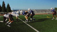 A football player runs the ball to the endzone in a scrimmage game - stock footage