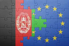 puzzle with the national flag of afghanistan and european union - stock photo