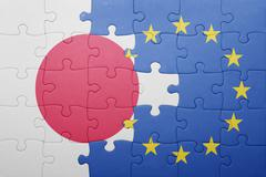 Stock Photo of puzzle with the national flag of japan and european union