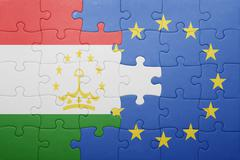 Puzzle with the national flag of tajikistan and european union Stock Photos