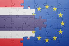 Puzzle with the national flag of thailand and european union Kuvituskuvat