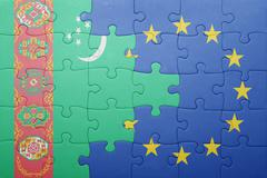 puzzle with the national flag of turkmenistan and european union - stock photo