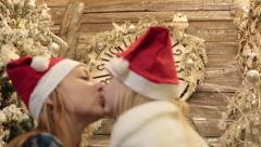 Mother and daughter in santa hats celebrate Christmas and New Year. Stock Footage