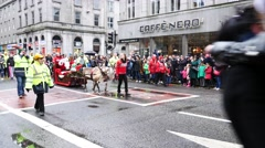 rowded people and The Christmas parade on the Union Street in Aberdeen - stock footage