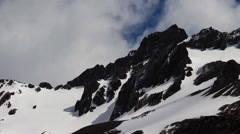Clouds over Glaciated Peak (4K) Stock Footage
