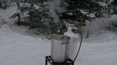 Outdoor cooking in winter - stock footage