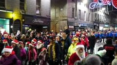 Rowded people and The Christmas parade on the Union Street in Aberdeen Stock Footage