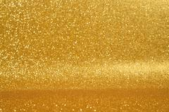 Golden glitter background Stock Photos