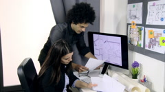 Male and female architects discussing project of home Stock Footage