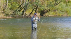 Fly- fisherman fishing in river Stock Footage