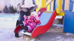 A child riding on a roller coaster Stock Footage
