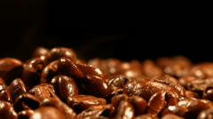 Coffee beans are steaming close up - stock footage