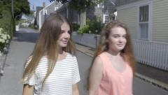 Two Teenage Girls Chat And Explore Beautiful Island Of Nantucket, Massachusetts Stock Footage