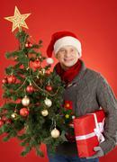 Man with xmas tree - stock photo