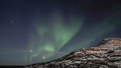 Gentle northern light dancing over a mountain - stock footage