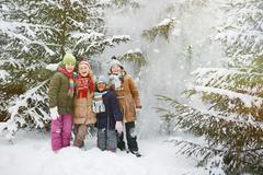 Friends in winter forest - stock photo