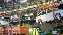 People work at assembly of cars Lada Samara on conveyor of factory AutoVAZ Stock Footage