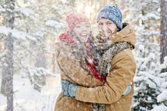 Enjoying snowfall - stock photo