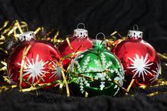 Colored Christmas balls on black velvet, ornament, xmas, snow Stock Photos