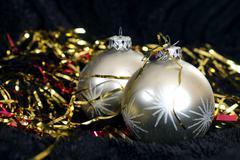 Stock Photo of Two silver Christmas balls on black velvet, ornament, xmas, snow