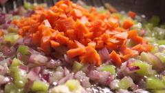 Roasting carrot, red onion and green pepper on a frying pan Stock Footage