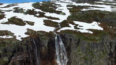 Breathtaking flight over tall waterfall in Norway, aerial footage Stock Footage