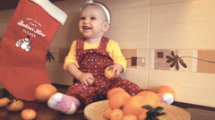 Child with oranges and tangerines Stock Footage